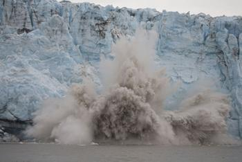 Image of a glacier calving. Click to learn about how rates of climate change have varied over time.